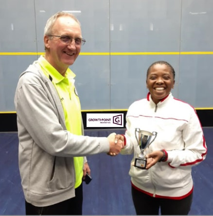 Chris Hughes (Thusong) handing over the trophy to Sharon Sibanda (Egoli